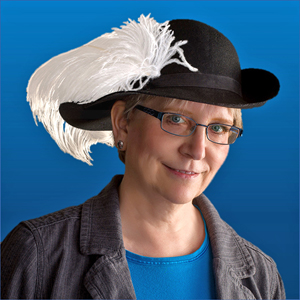 Judy's photo, which shows her wearing a hat with a large white feather.